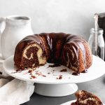 Image of fa Marble Bundt Cake on a white cake stand