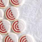 Image of strawberry pinwheel cookies with vanilla glaze.