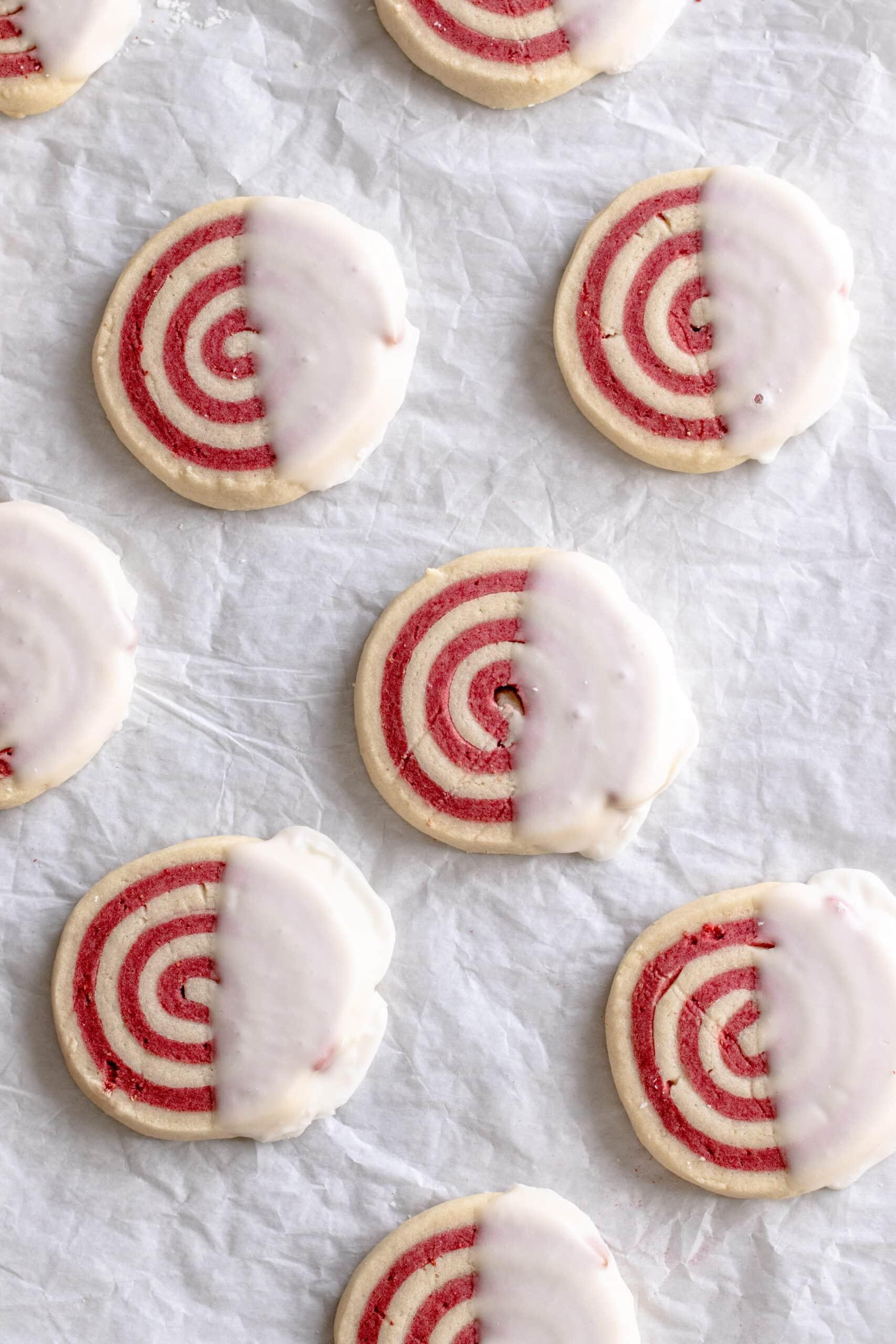 Image of iced strawberry and vanilla pinwheel cookies.