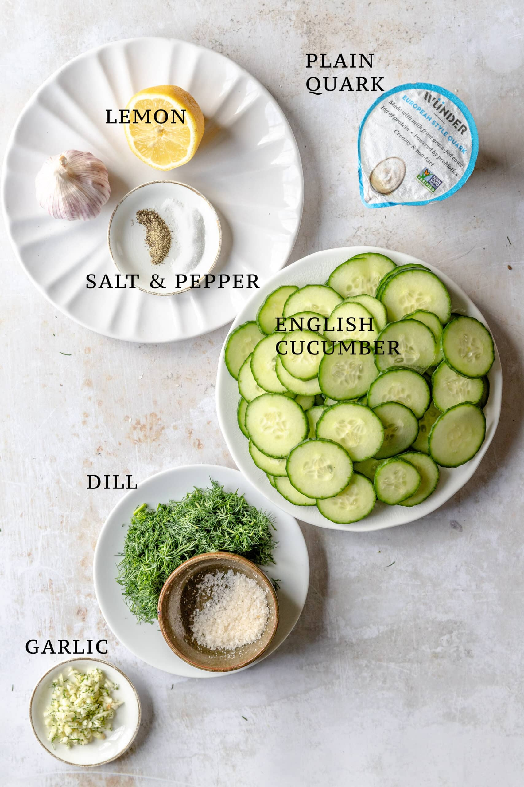 Ingredients spread out that are needed for gurken salat - cucumber salad.