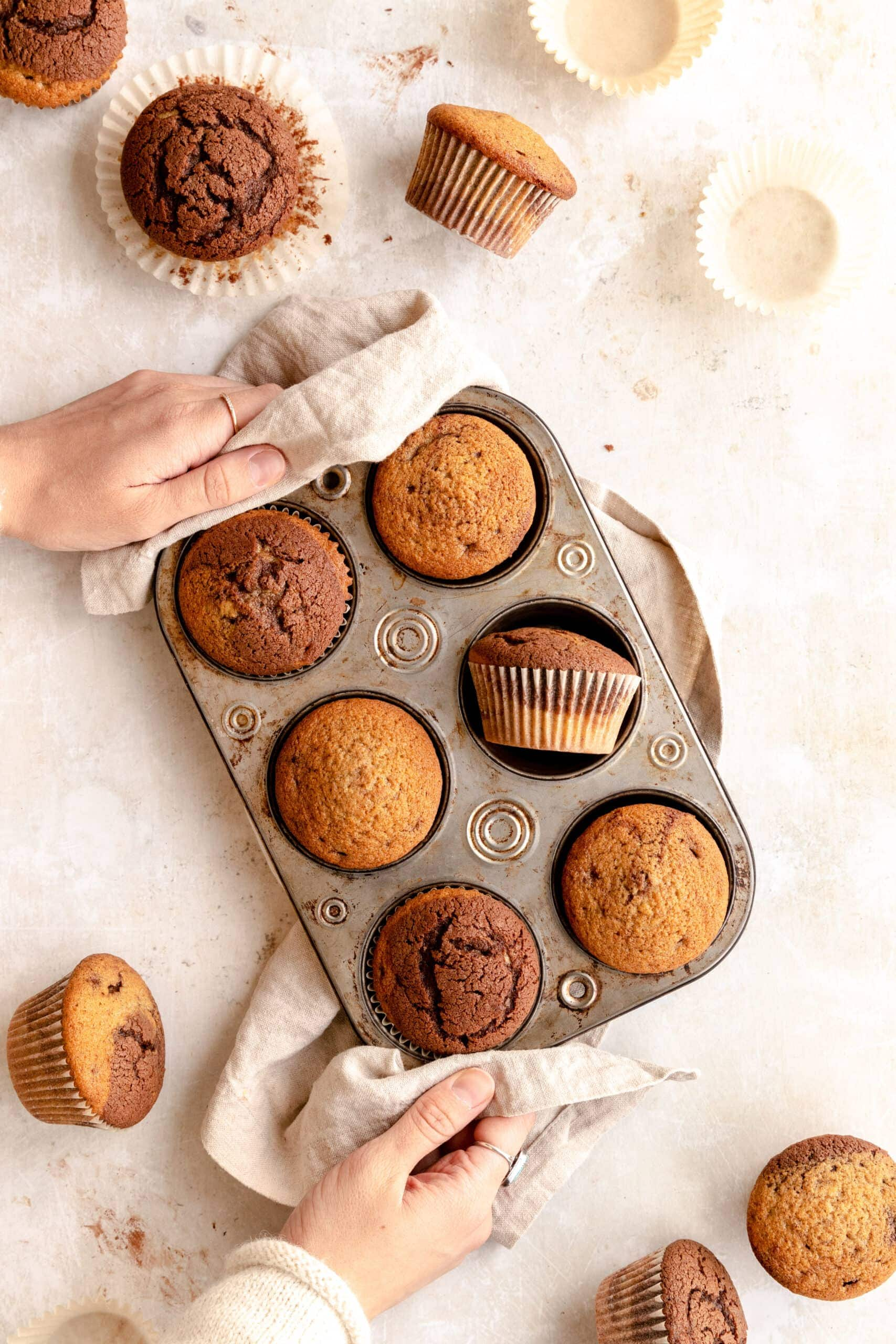 Spiced Marble Muffins in a muffin tin.