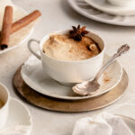 Cup of chai bayerische creme in a tea cup on a saucer.