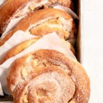 Overhead image of multiple apfelschnecken in a loaf tin.